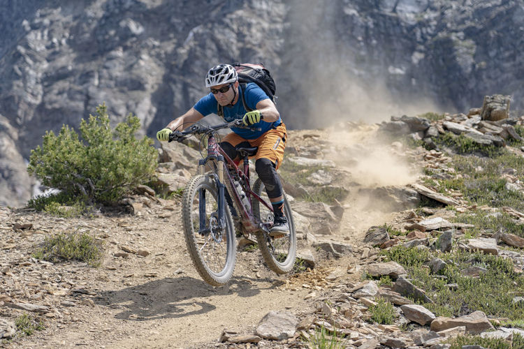 Cyclist Riding Bicycle On Mountain