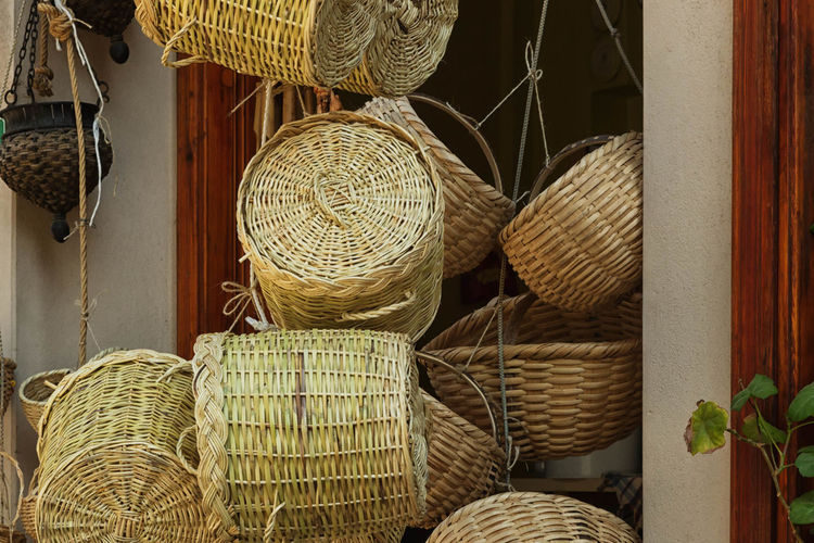 Basket Shop Abundance Arrangement Background, Bamboo, Basket, Brown, Cane, Circle, Close, Color, Container, Craft, Decoration, Decorative, Design, Dinner, Easter, Empty, Handle, Handmade, Illustration, Isolated, Kitchen, Lunch, Natural, Nature, Nobody, Object, Objects, Old, One, Organic,  Basket Choice Close-up Day Hamper, Creel, Pannier, Bushel; Wicker Basket; Mocuck Large Group Of Objects No People Repetition Retail  Side By Side Still Life Variation Wicker