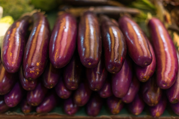 Close-up of eggplants for sale in market