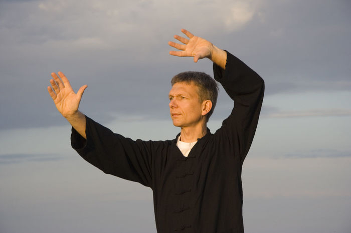tai chi - art of self-defense Arms Raised Fitness Healthy Lifestyle Man Martial Arts Mature Men Meditation Men Nature One Man Only One Mature Man Only One Person Qi Gong Real People Sea Spirituality Sport Sunset Tai Chi Tai Chi Chuan Taiji Taijiquan Waist Up Water Zen