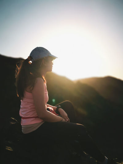 Wearing the luster that you left with me in the dark Hikingadventures Hiking Climbing Fitgirl Rocks Mountain Girl Hairstyle Hair Model Landscape_photography Sunset Shadow Shadows & Lights Pink Color Wireless Technology Technology Happiness Sports Clothing Relaxation