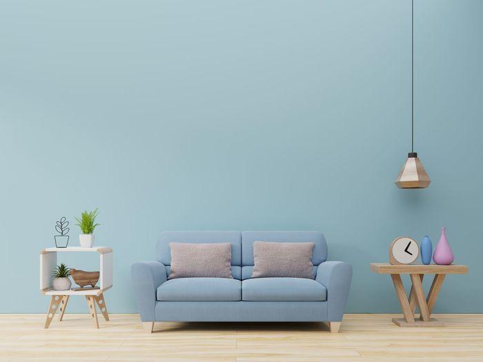 Furniture On Hardwood Floor Against Blue Wall