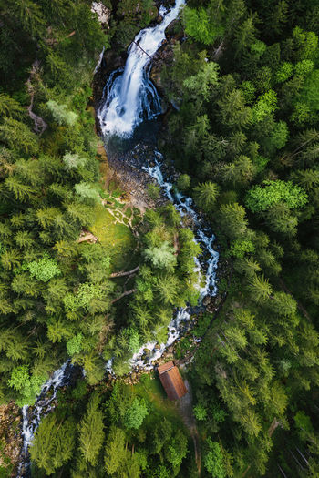 Aerial image of beautiful waterfalls near old mill in golling, salzburg, austria