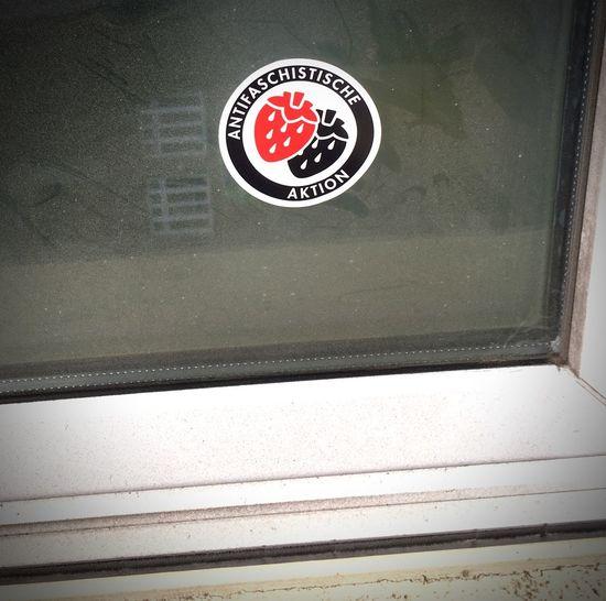 Antifaschistische Erdbeeren Antifaschistische Aktion Antifa Sticker Communication Sign No People Text Warning Sign Close-up Western Script