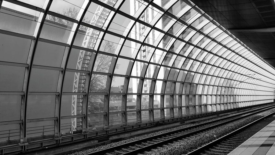 Railway Tracks By Glass Wall