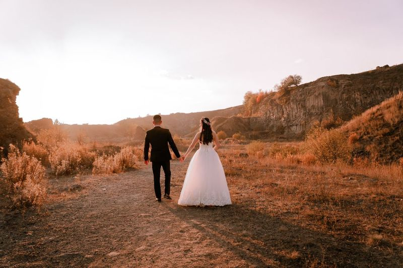 Rear view of couple walking outdoors