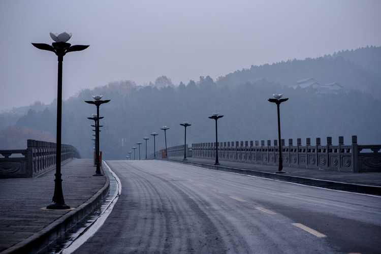 Street by road against sky during winter