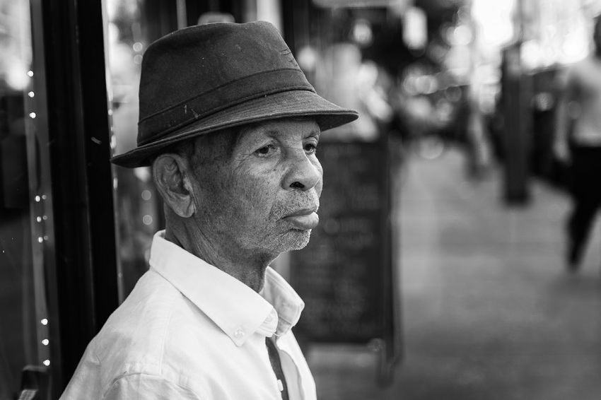 Shades Of Grey I went to visit a friend at his mothers salon in Queens NY when I seen his grandfather sitting on a chair out side on the side walk. I walked back to my car to get my camera and ask him can I take a picture of you and he smiled and said yes. After I took this picture I viewed my screen and realized how sick he looked and felt off the expression on his face, a few days later I was told he is in the hospital not doing so good. I am happy to say he pulled through and is feeling a lot better, GOD IS GOOD. David Gutierrez Pixelperfectnyc New York City Queens Grandpa Grandfather Pain Happyness Wisdom