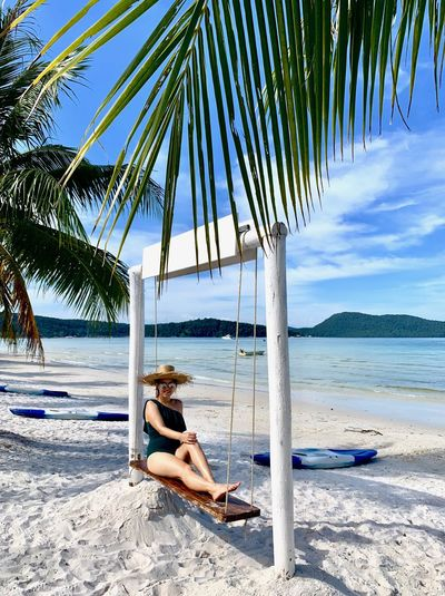 Cambodia ASIA Koh Rong Samloem Beach Sea Leisure Activity Full Length Sitting One Person Palm Tree Lifestyles Beauty In Nature Tropical Climate Real People Relaxation Nature Sand Outdoors Palm Leaf Island Life Beautiful Woman Beach Day Swing Sunbathing