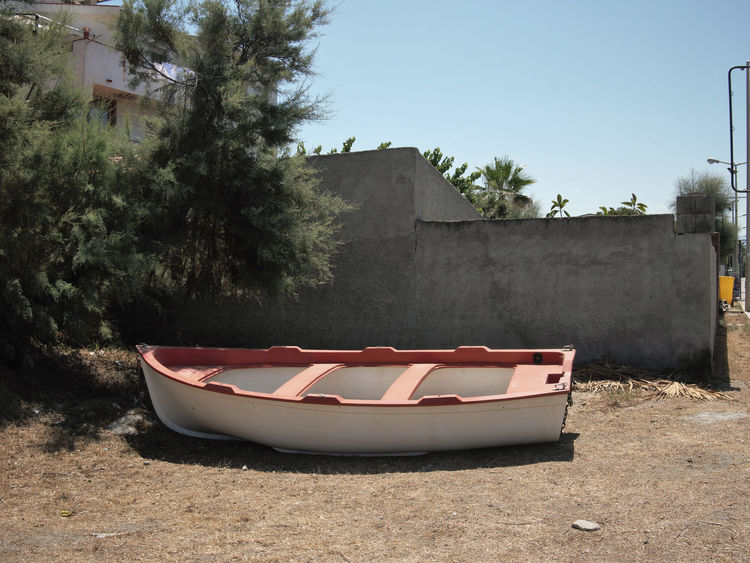 Abandoned Absence Architecture Boat Building Exterior Clear Sky Day Fishing Boat Grounded Leading Mode Of Transport Moored Nautical Vessel Obsolete Outdoors Real People Rowing Boat Seafood Southern Europe Transportation Travel Travel Trip Water Waterfront