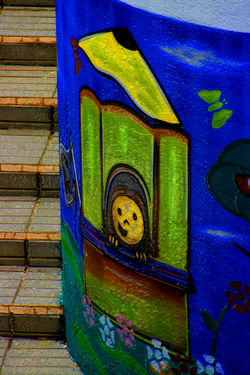 un niñito Architecture Art Blue Built Structure Close-up Closed Colorful Creativity Day Design Graffiti Green Color Multi Colored No People Outdoors Street Art Wall - Building Feature Wood - Material Wooden