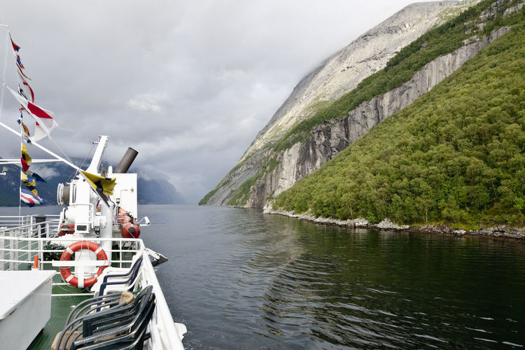 Travel on the ferry on Cloud Ferry Horizontal Lysefjord Nature Norway Reflection Rock Travel Beauty In Nature Cloud - Sky Day Europe Fjord Flags Landscape Mountain No People North Outdoors Peak Range Ridge River Wind