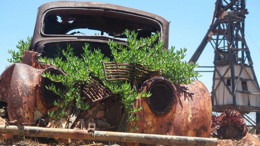Old rusty wheel against sky
