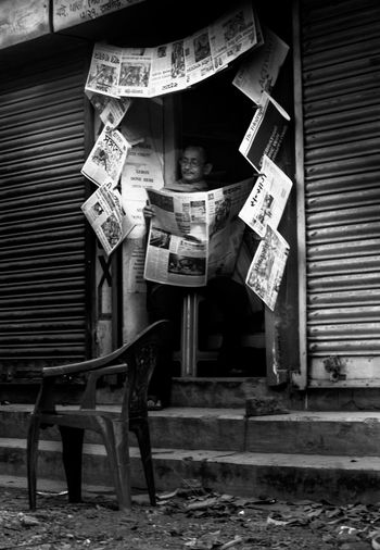 Better Together man and news paper