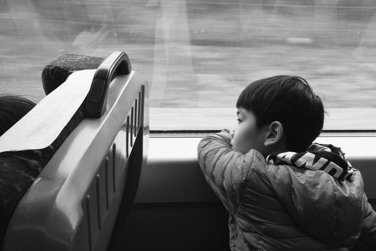 Young Boy Sitting On Bus