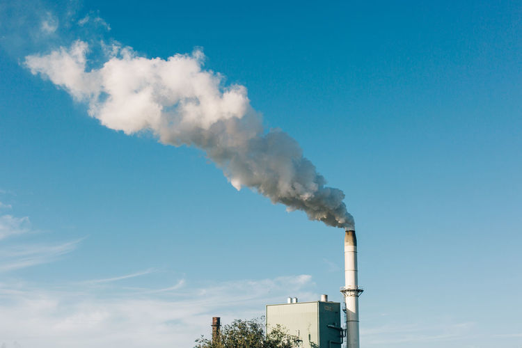 Factory Smoke Stack Pollution Smoke - Physical Structure Industry Building Exterior Emitting Environmental Issues Sky Air Pollution Chimney Fumes Environment Smoke Built Structure Chemical Chemistry Architecture Day Nature Ecosystem  No People Tall - High Atmospheric Outdoors
