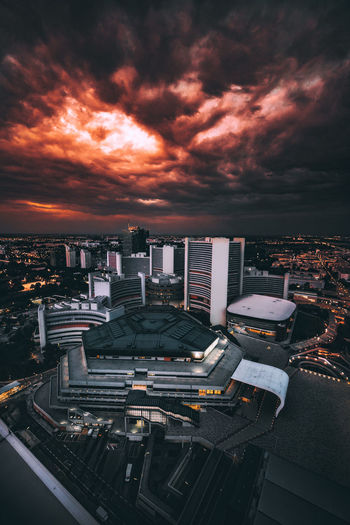 Light And Shadow Moody Sky Sunset EyeEm Best Shots Mood EyeEmNewHere Urbexphotography Rooftop Sonyimages EyeEm Selects Sony A7riii Urbex Urbanexploration VSCO Sky And Clouds Skyline Skyscraper City Cityscape Urban Skyline Illuminated Skyscraper Aerial View City Life High Angle View Dramatic Sky Sky Office Building Storm Cloud Lightning HUAWEI Photo Award: After Dark