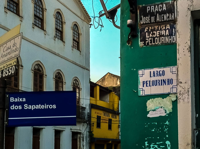 Crossroads #NSFM Architecture Baixa Dos Sapateiros Building Exterior Built Structure City Communication Crossroads No People Outdoors Pelourinho Road Sign Salvador Bahia Sky Street Tag Travel Destinations Historical Place