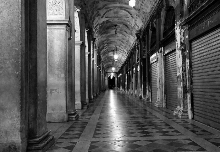 Black & White Getty Images Absence Arcade Arch Architectural Column Architecture Black And White Building Built Structure Ceiling Colonnade Corridor Day Diminishing Perspective Direction Electric Lamp Flooring History Illuminated Incidental People Indoors  Lighting Equipment The Past The Way Forward