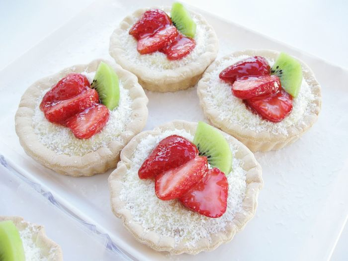 High Angle View Of Strawberry Tarts On Table