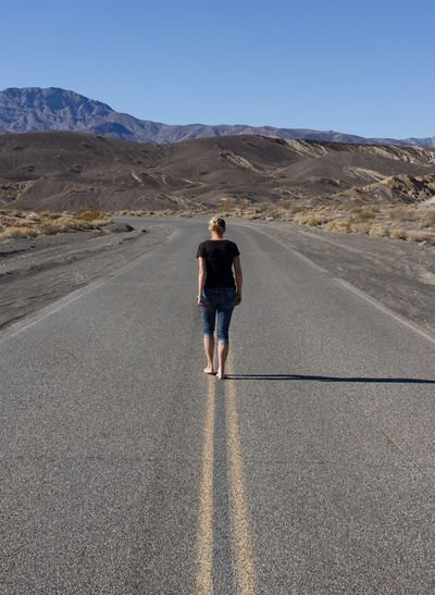 Full Length Rear View Of A Woman Walking