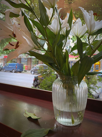 Close-up of wet glass vase on table