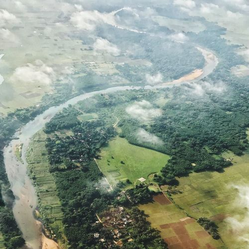 Birds eye view of a river approaching its delta. Bestoftheday View From Above Green Water Nature Earth From The Sky Colouds Beautiful Avaiation River Water Nature High Angle View Aerial View Environment Beauty In Nature Landscape Scenics - Nature Agriculture Tree Window Outdoors Land Pattern Tranquility First Eyeem Photo