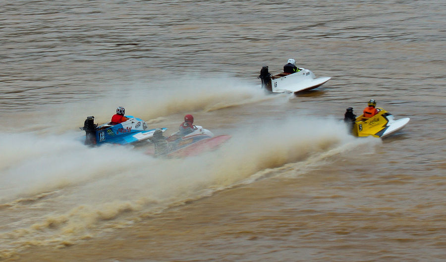 powerboat racing at river Adventure Beauty In Nature Competitive Sport Day Extreme Sports High Angle View Jet Boat Leisure Activity Lifestyles Men Motion Nature Nautical Vessel Outdoors Powerboat Race Real People River Speed Sport Transportation Water Waterfront Watersport