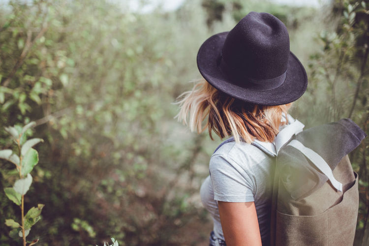 Close up of hiking girl with backpack and hat EyeEm Gallery EyeEmNewHere Freedom Fun Life Travel Adult Casual Clothing Day Focus On Foreground Girl Good Times Good Vibes Hat Headshot Hipster Leisure Activity Lifestyles Nature One Person Outdoors People Real People Windy Women