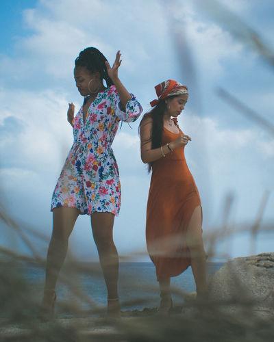 Female friends dancing at beach