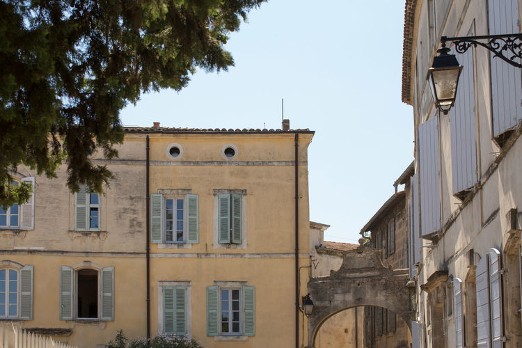 Building exterior at the old town, Arles Arch Architectural Detail Architecture Branch Building Exterior Built Structure City Clear Sky Day Façade Lamp Post Low Angle View No People Old Town Outdoors Residential Structure Sky Tall - High Tourism Tower Travel Destinations Window