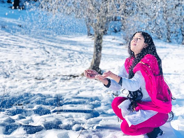 She is not wearing makeup so her face just looks like skin with White rain drops falling... Girl Smile Beautiful Innocence Happiness Babygirl Blackandwhite Eyes Eyelashes Softskin Landscape In Pink And White Lady In Salwar Suit Snowfall Girl Playing In Snow Natural Beauty Freedom Snowfall Snow Indian Girl Indian Wear Winter Cold Temperature One Person Nature Fun