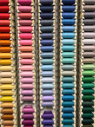Beautifully Organized Bobbins Sewing Thread Spools Multicolored Many Store Commerce