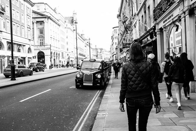 Mono streets Architecture Built Structure Casual Clothing City City Life City Street Day Fujifilm_xseries Group Of People Leisure Activity Lifestyles Medium Group Of People Mixed Age Range Outdoors Road Showcase June Sky Street The Way Forward My Commute