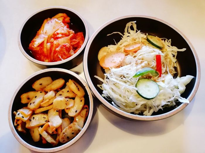 Korean side dishes (ie. Banchan). Spicy Food Fermented Cabbage Fresh Salad  Fish Cakes Sesame Seeds Savoury Food Yellow Onions Capsicum Pepper Cabbage Carrot Slices Cucumber Slices Salad Dressing Side Dishes  EyeEm Selects Bowl Korean Food Plate Appetizer