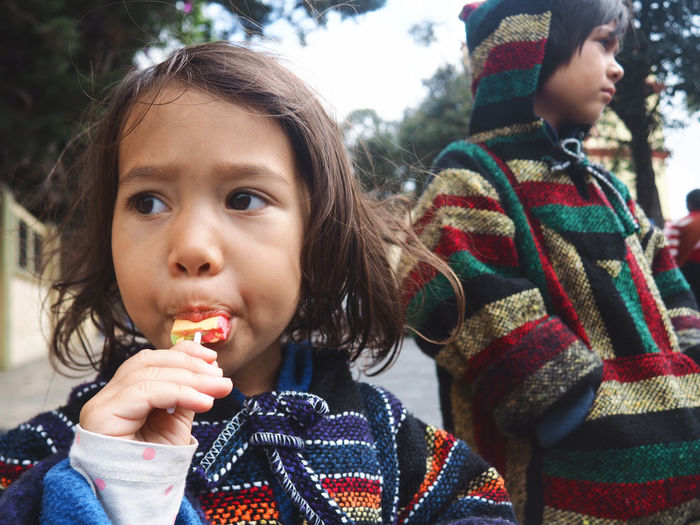 Lollipop time in San Cristobal de las Casas, Mexico. Boy Brother Child Childhood Close-up Day Eating Girls Headshot Lollipops Mexican Culture One Person Outdoors People Portrait Real People Siblings Sister Sweet Sweet Food Traditional Clothing