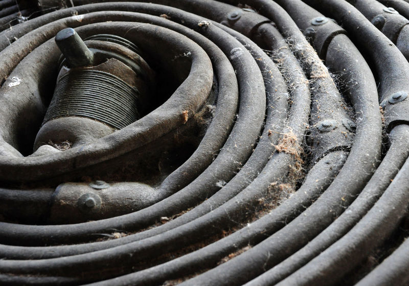 Abstract Coiled Disrepair DISUSED Fire Hose Grey Hose Pipe Obsolete Old Reel