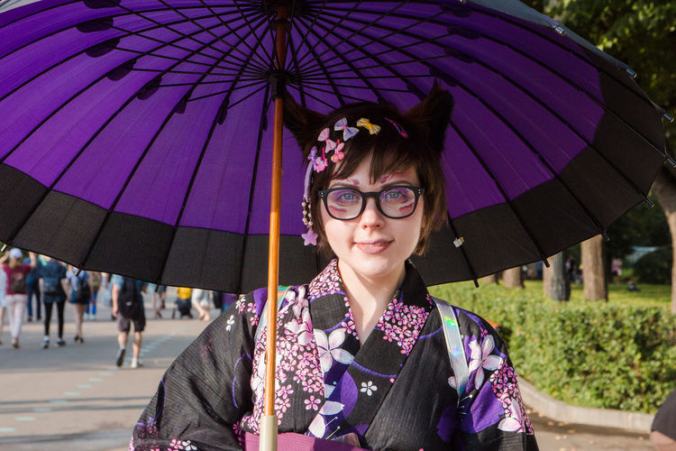 Girl in japanese dress Clothing Day Fashion Females Front View Glasses Innocence Leisure Activity Lifestyles Looking At Camera One Person Outdoors Portrait Protection Purple Rain Real People Security Smiling Standing Umbrella Women Young Adult