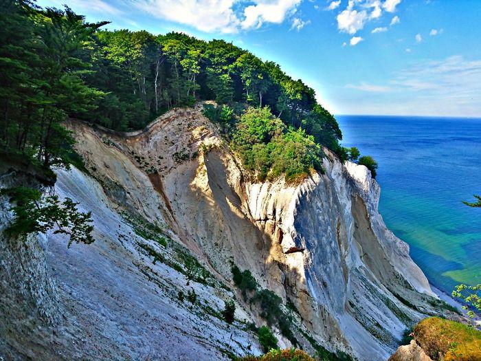 Møns Klint, Denmark Trees Møns Klint Tree Water Sea Beach Blue Mountain Sky Horizon Over Water Cloud - Sky Rock Formation Coast Cliff Rock Geology Rocky Coastline EyeEmNewHere The Great Outdoors - 2018 EyeEm Awards