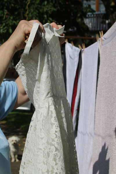 Bride Dress Casual Clothing Close-up Cropped Day Focus On Foreground Hands At Work Hands In The Air Holding Leisure Activity Lifestyles Midsection Outdoors Part Of Person Selective Focus Unrecognizable Person