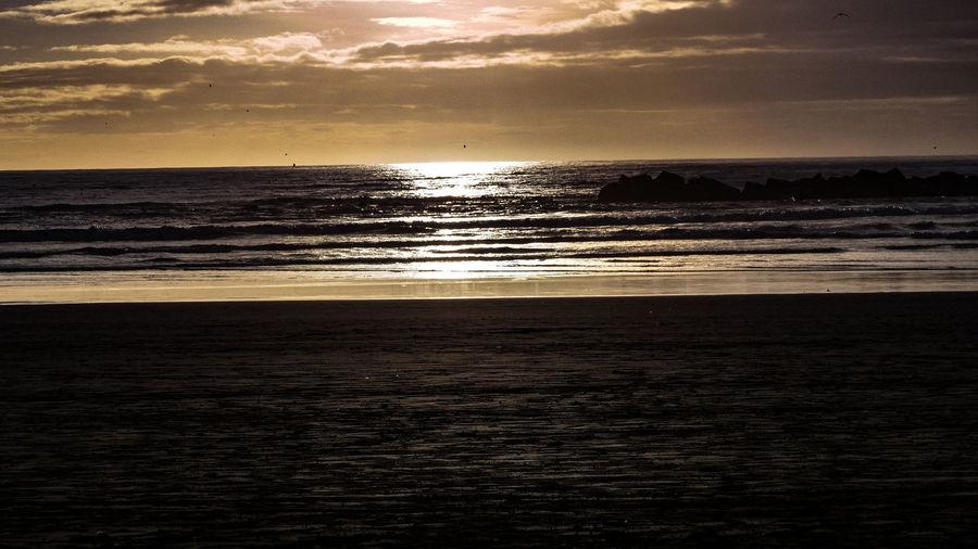 sunset Sea Sky Horizon Over Water Water Horizon Land Scenics - Nature Beach Cloud - Sky Beauty In Nature Sunset Tranquility Nature Tranquil Scene Wave No People Idyllic Motion Outdoors