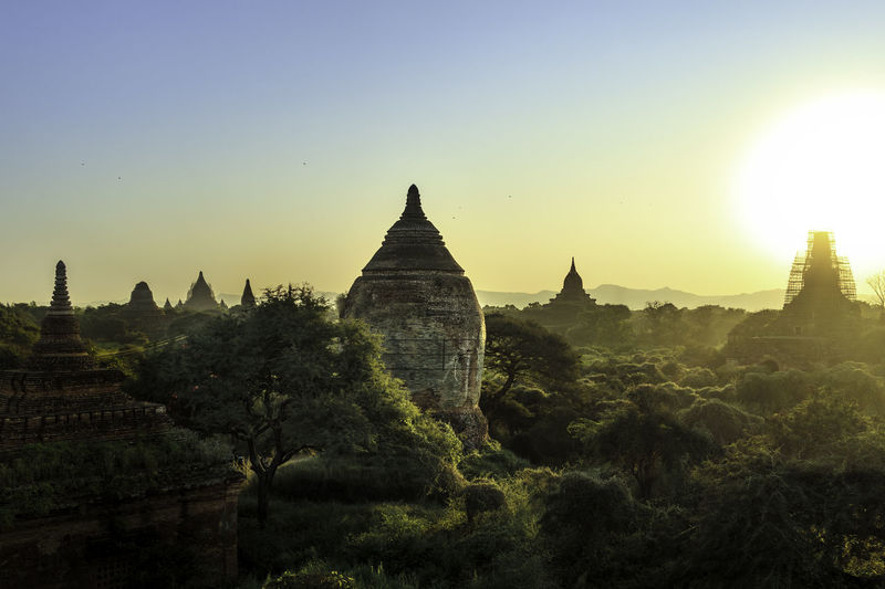 Bagan Evening Lights Green Color Pagoda Trees Ancient Architecture Bagan Burma Clear Sky Day Landscape Myanmar No People Outdoors Pagoda Religion Sky Spirituality Sunset Temple Travel Destinations