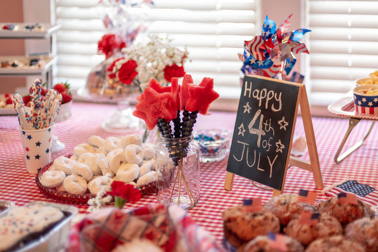 Party food for Fourth of July brunch in red, white and blue theme - food and drink, entertaining at home Breakfast Entertaining Home July 4th Party Food Brunch Buffet Celebrate Celebration Chalkboard Decoration Decorative Donut Event Food Food And Drink Fourth Of July Happy Fourth Of July Holiday Independence Day Indoors  Party Selective Focus Table Watermelon