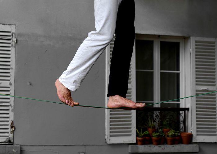 Magic streets Trapeze Artist Architecture Built Structure One Person Building Exterior Low Section Human Body Part The Street Photographer - 2018 EyeEm Awards Body Part Lifestyles Real People Window Standing Day Outdoors Leisure Activity