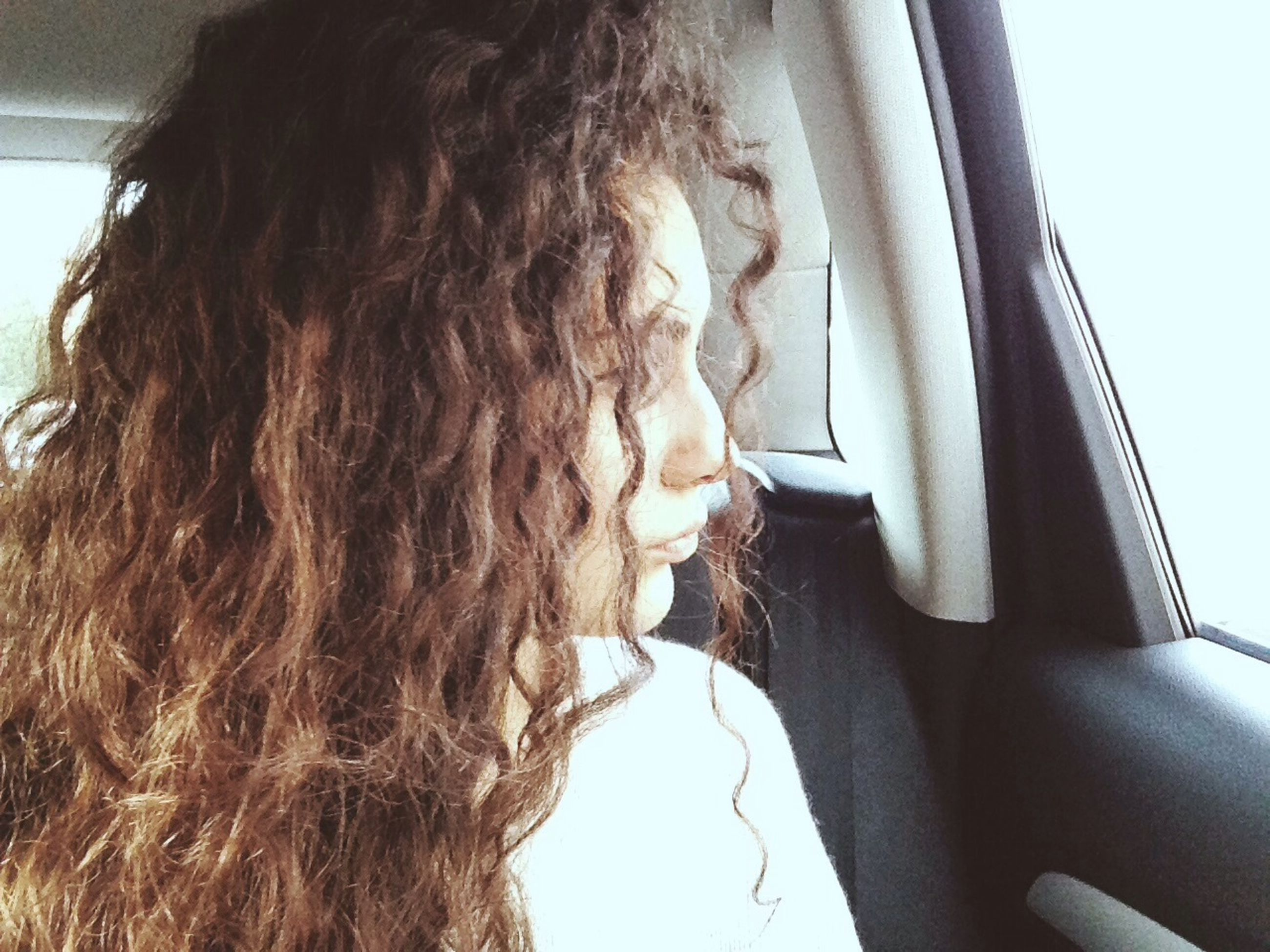 lifestyles, indoors, young adult, young women, leisure activity, long hair, headshot, person, transportation, human hair, window, vehicle interior, close-up, rear view, car, side view, day