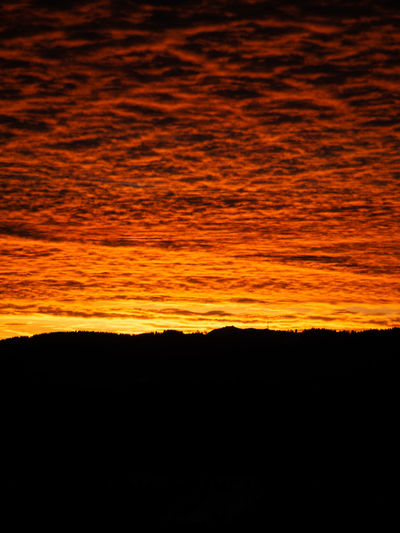 Sunset Silhouette Orange Color Sky Scenics - Nature Beauty In Nature Cloud - Sky Nature Tranquility Tranquil Scene No People Idyllic Environment Outdoors Dramatic Sky Dark Copy Space Backgrounds Landscape Majestic