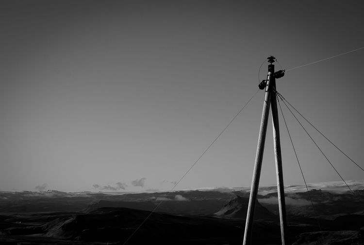 Nature Blackandwhite Sky Lines Day Outdoors Nowhere Lost Sepia Electricity  Mountain Panoramic Iceland Cable Clear Sky Standing Out No People Electricity Pylon Low Angle View Single Object Telephone Line