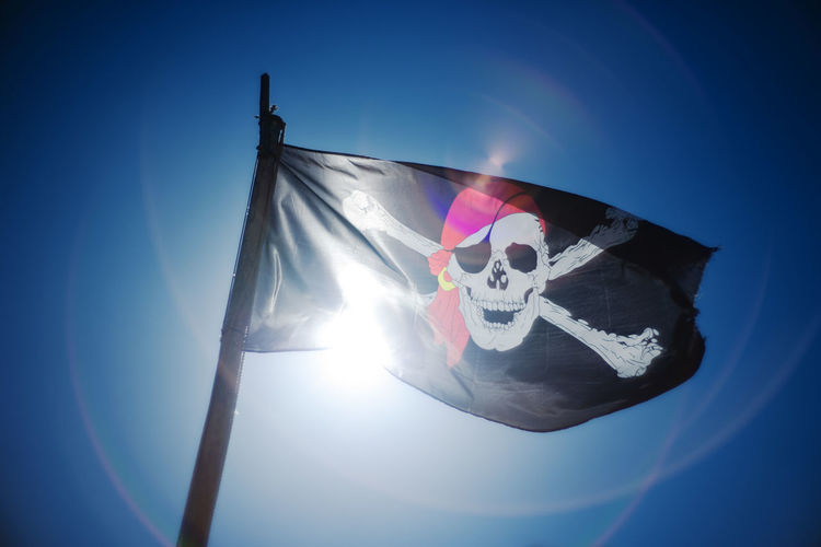 Yarr me hearties! Bright Pirate Blue Clear Sky Day File Sharing Flag Lens Flare No People Outdoors Piracy Sky Sun Sunbeam Sunlight