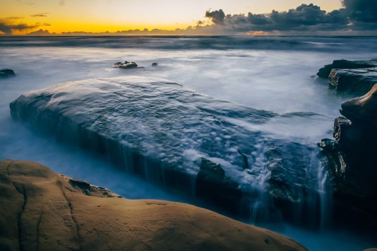 EyeEm Selects Beauty In Nature Nature Scenics Water Tranquil Scene Tranquility No People Idyllic Outdoors Sea Power In Nature Motion Sunset Travel Destinations Wave Day Landscape Waterfall Sky Hot Spring