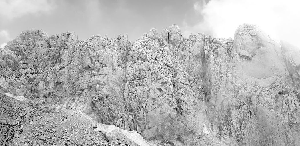 On the edge of the rock Blackandwhite Mountain Rock Bigrock Backgrounds Spraying Water Sky Close-up Cloud - Sky